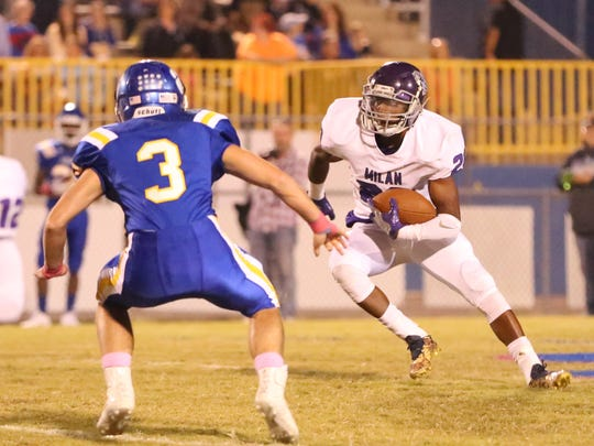 Milan's Jacquez Norman (20) cuts up the field against McNairy Central on Oct. 13, 2017.