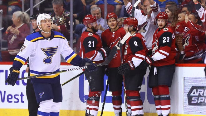 Mar 31, 2018: Arizona Coyotes right wing Richard Panik (14) celebrates with teammates after scoring a second period goal as St. Louis Blues left wing Jaden Schwartz (17) reacts at Gila River Arena.