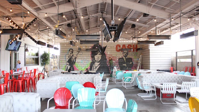 Culinary Dropout at the Yard Tempe features flat-screen televisions for sports viewing, backyard-style games and a stage for live music.