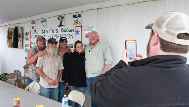 "Cedric Poynor, right, poses with ""Swamp People"" Justin Choate, Glenn Guist, Liz Cavalier Choate and Jessica Cavalier on Sunday."