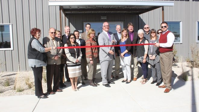Concho Resources Inc., held an official ribbon cutting of their Carlsbad office on Nov. 12. Members from the Carlsbad Chamber of Commerce assisted with the ribbon cutting.