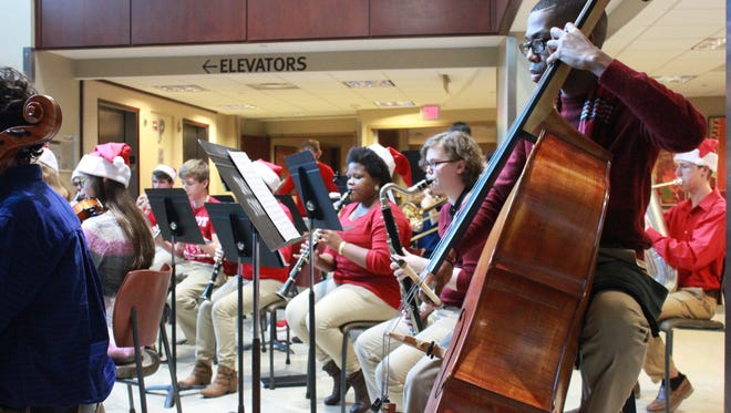 Members of the Jackson Symphony Youth Orchestra perform Sunday at the Jackson-Madison County General Hospital.