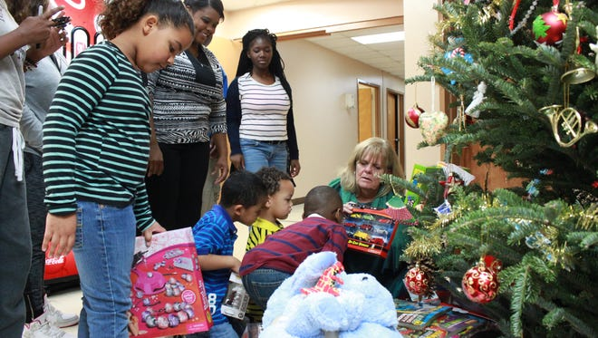 Gail Gustafson, executive director, passes out gifts to students at the Dream Center.
