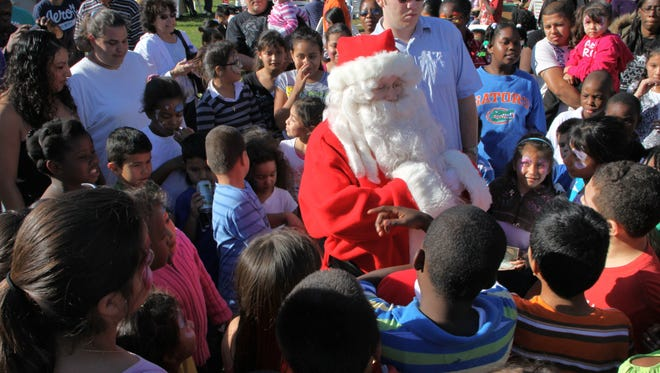 Santa arrives at the 2011 Operation Hope Christmas party to benefit about 3,500 children and adults.