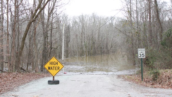 Floodwaters block a road in Crump on Wednesday.