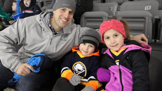Nick Ballou, of Penfield, with kids Ryan, 4, and Celina, 6, at a recent RIT men's hockey game at the Gene Polisseni Center in Henrietta.