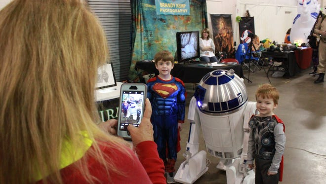Carson Teuton, 6, and Mason Teuton, 4, pose with R2-D2 Sunday at the Southern Fried Pop Culture and Comic Con.