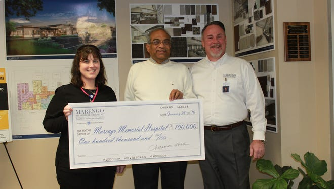 Dr. Chirantan Ghosh, center, presented a check for $100,000 to go toward the major building and renovation project at Marengo Memorial Hospital to its chief executive officer Barry Goettsch, right, on Jan. 28. Dr. Ghosh is the hospital's oncologist. Tina Welsh, RN, outpatient clinics manager, is at left.