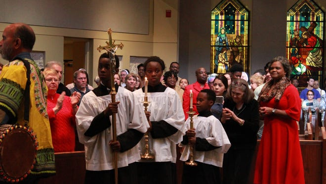 The processional leaves as the Afrocentric Mass ends Sunday at St. Mary's Catholic Church.