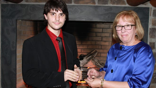 """Peter Kehayes (left) received an award for """"Outstanding Program Graduate"""" from Jill Zabowski, CEA Director of Placement and Program Development at CEA's """"An Evening at the Lodge"""" fundraiser."""