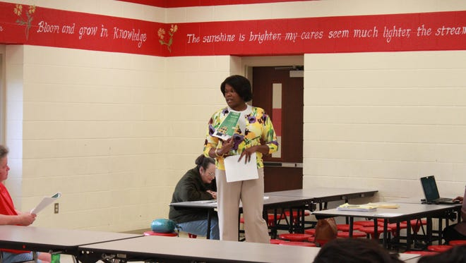 Janet Gore, future principal of Isaac Lane Elementary School, speaks during a community forum Tuesday at Arlington Elementary School.