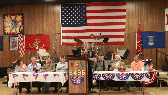 Vietnam veteran Tom Buck speaks at the Veterans of Foreign Wars Post 6496 Sunday at an event to honor retiring soldiers Tony Higgins and Chris Richardson.