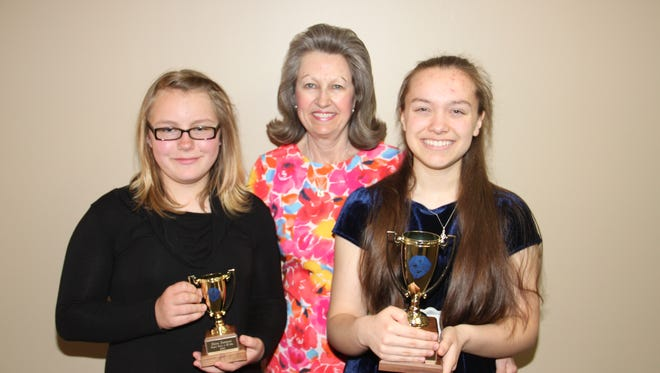 Area piano students recently performed in the Junior Festival at Evangel University in Springfield, Mo. Emma Darracq, left, received her first Gold Cup trophy and Heather Spencer, right, her third Gold Cup trophy. Caryl Reddick, teacher.