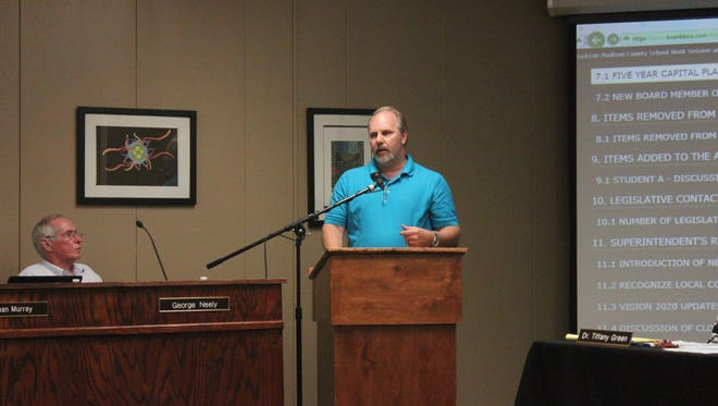 Allen Powell, director of maintenance and operations, speaks to the Jackson-Madison County School Board Monday.