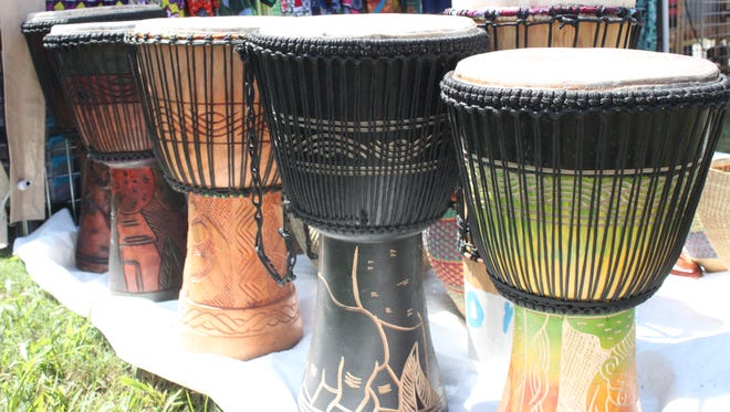 A vendor sells African drums Sunday at the African Street Festival.