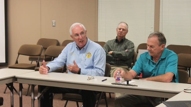Buddy Gresham, budget director for the Madison County Sheriff's Department, explains the idea for a new training facility at an education vision committee meeting Tuesday.
