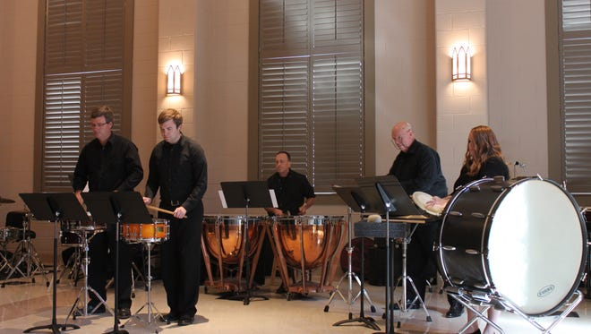Members of the Jackson Symphony's percussion ensemble perform 'Fanfare for Percussion' Sunday at St. Luke's Episcopal Church.