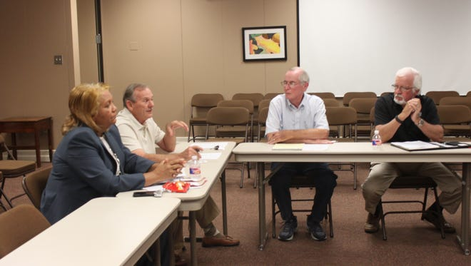 Members of the Jackson-Madison County School Board and the Madison County Commission meet during an Education Vision Committee meeting Tuesday.