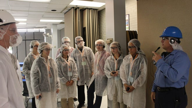 David Dunning, maintenance supervisor, gives a group of South Side High School students a tour of Pinnacle Foods on Wednesday afternoon.