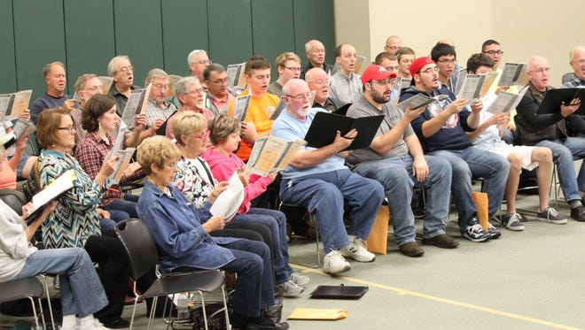 Members of the Lancaster Community Chorus rehearse for it's Nov. 13 performance.