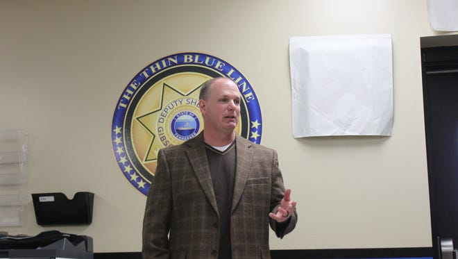 Gibson County Sheriff Paul Thomas announces the dedication of the Sheriff Joe M. Shepard Memorial Squad Room Sunday at the Gibson County Correctional Complex.