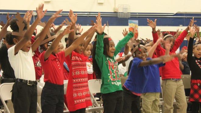 "First-grade scholars sing ""Blitzen's Boogie""  during Lincoln Elementary School's Christmas Celebration Thursday."