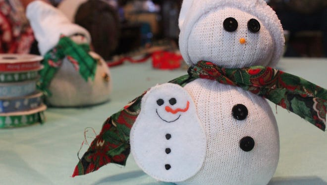 Dorothy Davis makes sock snowmen, in addition to many other crafts.