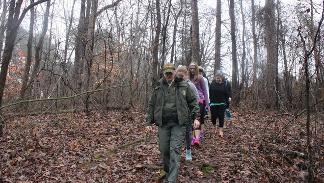 Park Ranger Ann Paley leads a group of hikers on a 'First Day Hike' Sunday at Chickasaw State Park.