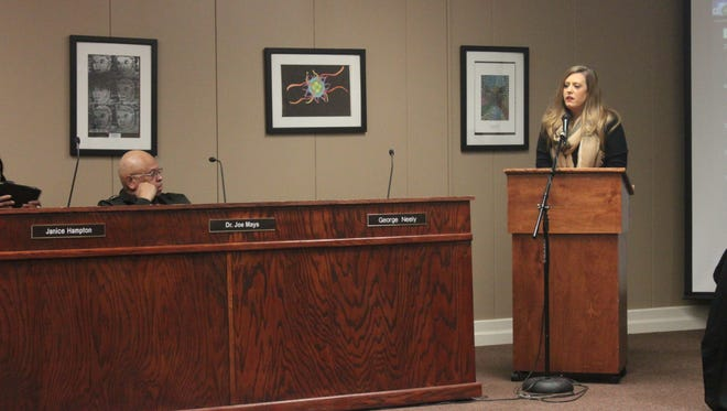 Parent Beth Parnell speaks to the Jackson-Madison County School Board about Whitehall Pre-Kindergarten Center, where her son attended school until it was shut down due to hail damage.