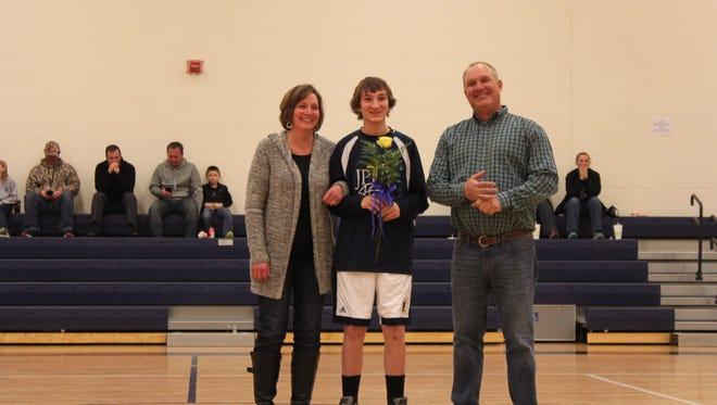 8th grader Zack Mason with his parents, Mary Beth and Joe Mason.
