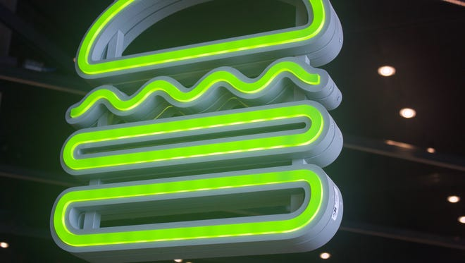 Shake Shack's neon burger is becoming an icon as the chain opens across America. This one's at MGM National Harbor just outside D.C.