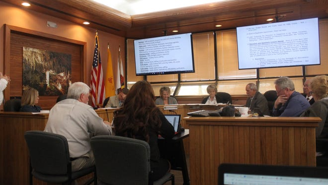 Eddy County Finance Director Roberta Smith and Assistant County Manager Kenney Rayroux discuss the budget with the Eddy County Board of Commissioners Tuesday at the Eddy County Administration Building.