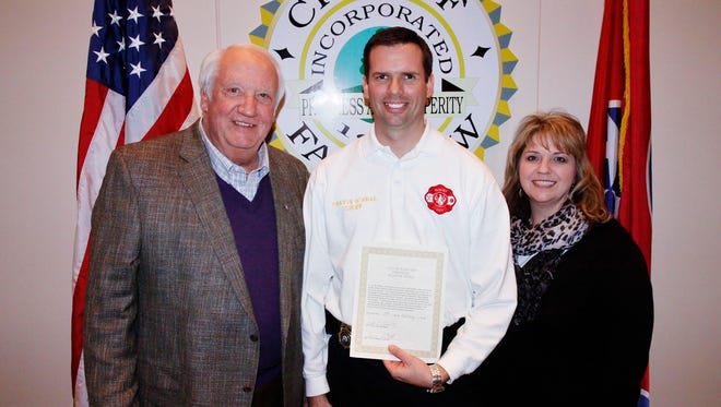 Fairview's fire chief Travis O'Neal (center) has stepped down from the position to take a senior fire fighter role. Pictured with then city manager Wayne Hall and Mayor Patti Carroll.