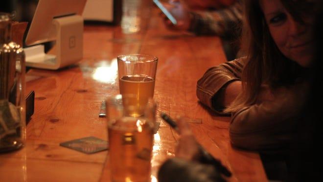 Customers enjoy craft beer Friday at Milton's Brewing.