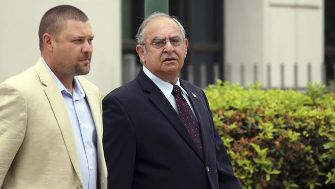 Louis Ackal, right, leaves the Lafayette federal courthouse in this file photo.