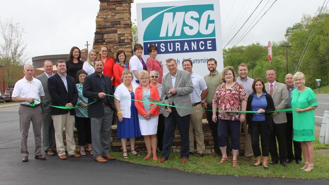 The team of Mann, Smith & Cummings Insurance celebrates their CMC Green Certification with local leaders.