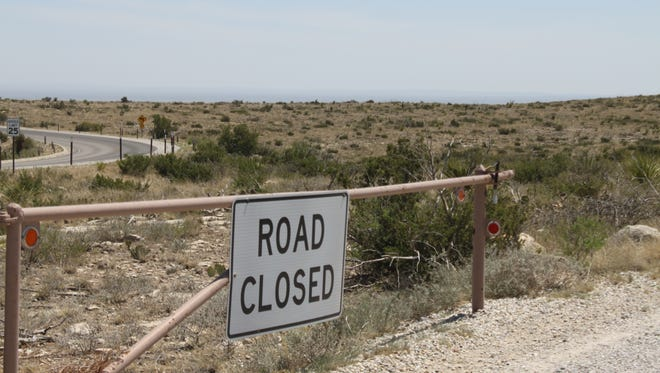 Police and rescue crews used the Rattlesnake Canyon trailhead to search for a father and son reported missing at Carlsbad Caverns National Park. The son was found dead Monday night. The father was found dead Tuesday about a mile from his son.
