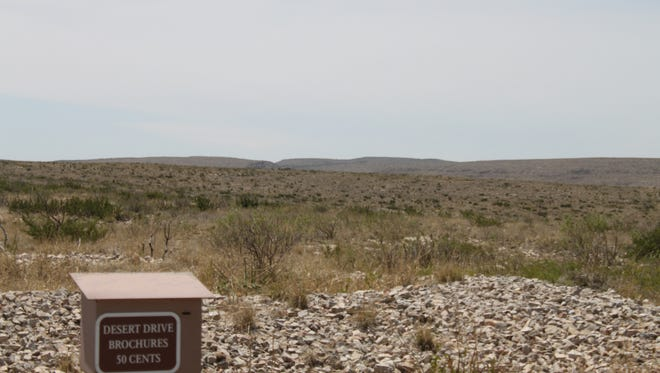 Police and rescue crews utilize the Rattlesnake Canyon trail head to search for a father and son reported missing at Carlsbad Caverns National Park.