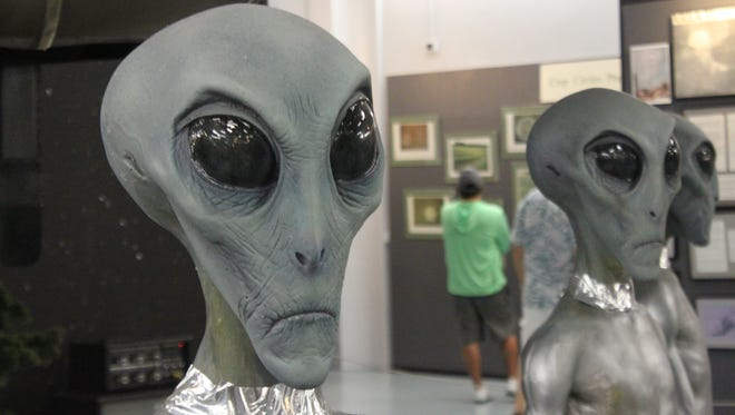 Attendees visit the UFO Museum during the second day of the Roswell UFO Festival, Friday in downtown Roswell.