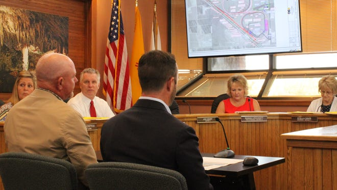 David Friesen (left) and Jonathan Green of CIG Logistics discuss a new facility with Eddy County commissioners, July 11, at the Eddy County Administration Building in Carlsbad.