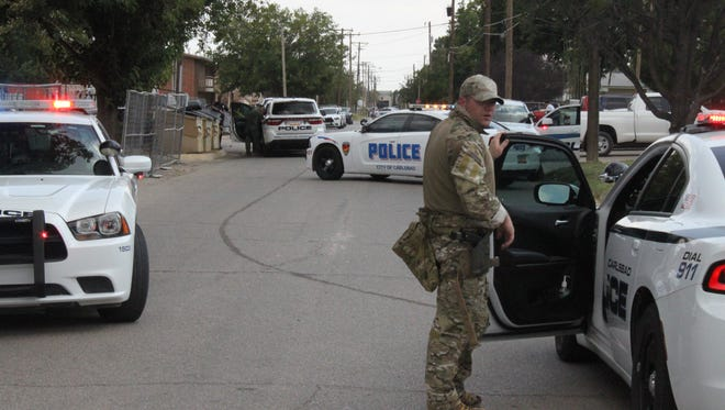 Carlsbad police engage in a standoff Thursday in the 600 block of North Fifth Street.