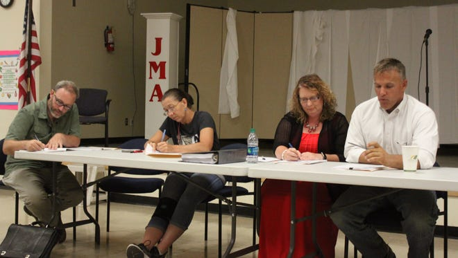 Members of the Jefferson Montessori Academy Council of Trustees discuss school business during their regular meeting, Thursday, July 20, 2017.