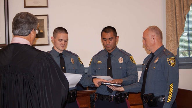 Judge Kenneth Clark, Jr. swears in Officers Daniel Howard (left) and Brayan Chavez-Rivera with assistance by Chief R. L. Hughes.