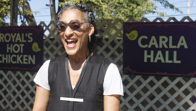 "Top Chef finalist Carla Hall, who now co-hosts ABC's ""The Chew,"" serves a hot chicken dish at the Bourbon & Beyond Chicks & Champs Gospel Brunch."