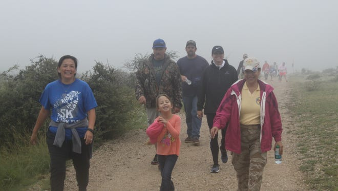 Hikers complete the one-mile trail for the annual March for Parks, Sept. 30 at Living Desert Zoo and Gardens State Park.