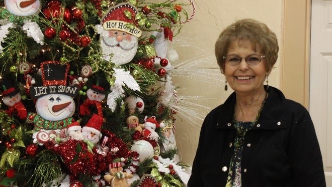Brenda Day designed and hand painted this Christmas tree, and it sold for $520 a foot at the Assistance League of Carlsbad's annual tree auction.