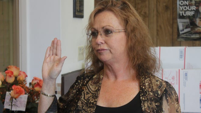 Ronda Smith is sworn in as postmaster, Oct. 26 at the Carlsbad Post Office on Canyon Street.