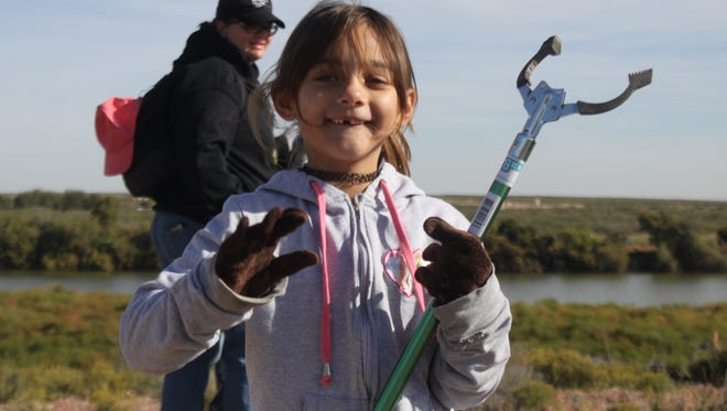 Volunteers help clean up the Six Mile Dam area along the banks of the Pecos River for National Public Lands Day, Oct. 28 at the Six Mile Dam.