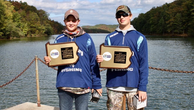 Dylan Barefoot (left) and Carson Forrester (right) pose with their plaques after winning the Junior BASS State Championship
