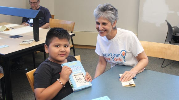 Alisa Kesten with a young participant in the JCY Summer Reading Buddies program at the Yonkers Riverfront Library.